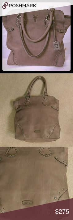 Frye excellent condition large tote Like NEW Frye Large tote. Genuine leather, durable and yet is soft to the touch. Multiple pockets, and a large zipper pocket. This is great size for overnight or the office. Approx 15X15, 9 inch drop. The color is a soft grey taupe, will work with any outfit, and will last a lifetime. Frye Bags Totes