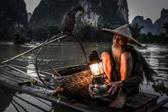Cormorant fisherman in Xingping by Terje Madsen on 500px. -with bird.