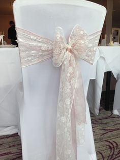 White lycra covers with pale dusky pink & lace sashes entwined x