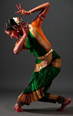 Danseuse [female ballet dancer] performs in the Eastern Indian style.