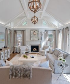 Loving the light and airy feel of this Maryland remodel. The grasscloth backed bookshelves add texture and interest in the family room. And we just can't get en