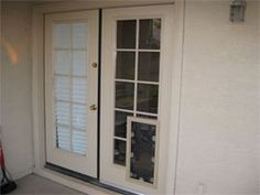 Our doggie doors and cat doors stand out because of their superior craftsmanship, and we offer a number of exciting options including sliding glass dog doors, doors with dog doors, doggie doors for walls and windows and more.