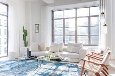 CH25 easy chairs - Hans Wegner - Carl Hansen & Son - The New Design Project mixes styles and colours in renovated Manhattan apartment | Dezeen