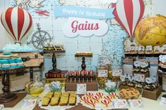 Vintage airplane hot air balloon boy birthday party dessert table!  See more party planning ideas at CatchMyParty.com!