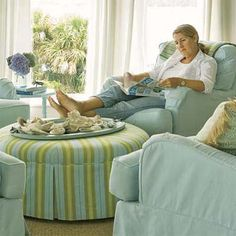 reading chair and love that big round ottoman/coffee table, nice color if it has to be plain. Oversized Chair And Ottoman, Round Ottoman, Ottoman Table, Upholstered Coffee Tables, Big Comfy Chair, Outdoor Rocking Chairs, Warm Home Decor, Cool Chairs, Slipcovers