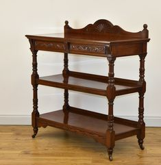 An antique walnut buffet/serving table with two drawers, standing on brass & porcelain castors. Made by Trevor Page of Norwich. Circa Delivery is INCLUDED in the Table Furniture, Antique Furniture, Buffet Server Table, Serving Table, Wall Fixtures, Drawer Fronts, Free Delivery, Wales, Hand Carved