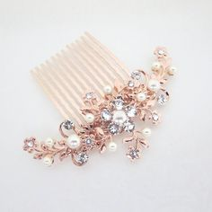 Prep your winter updo with the help of this crystal + pearl bedazzled hair comb.