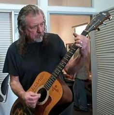 Robert Plant with an Elvis Presley guitar                              …