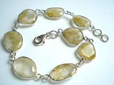 Fine sterling silver golden rutile quartz bracelet.