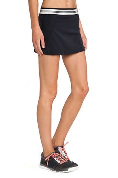OLYMPIA Activewear Naia Tennis Skirt in Black Mesh | REVOLVE