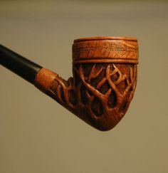 """The Bruce   The inscription around the rim is the same elvish inscription found on the """"one ring"""" from the Lord of the Rings trilogy. """"The Bruce"""" is a churchwarden briar, with an 8″ vulcanite stem.   One of the many pipes by Jonathan Drake. http://pipesbydesign.com/"""