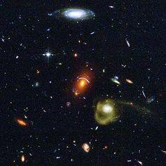 An Eclectic Mix of Galaxies - Credit: NASA, ESA, J. Blakeslee and H. Ford (Johns Hopkins University)