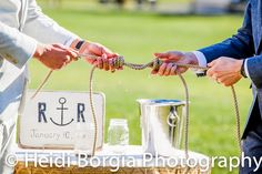 Tying The Knot: Tie a triple fishermans knot in place of a candle or sand ceremony for our nautical background.