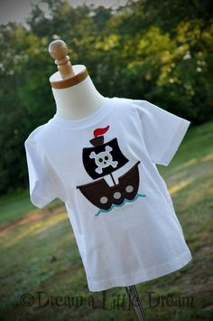 Craft project for kids with iron on shapes Pirate shirt idea.  Sooo cute!