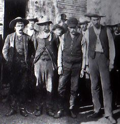 This photo was taken at Medicine Lodge, Kansas just after the robbery. From left to right, John Wesley, Henry Brown, Billy Smith, and Ben Wheeler. The four robbers were lynched a few hours after this photo was taken