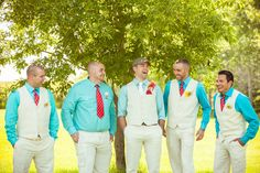 grey vests black pants white shirts colored ties and boutonnieres.