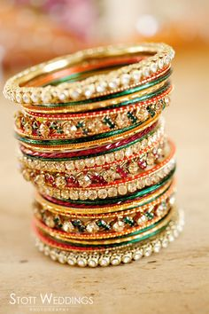 Would be a good idea to stack up all the bangles that the bride is going to wear an click a picture..Indian Wedding Photography