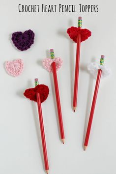 We're in LOVE with yarn hearts and can't get enough of them. Add a pencil to them to make crochet heart pencil toppers and they are even more heart-tastic!