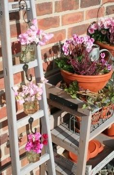 Ladder plant hanger. Cute idea to use with mason jar as the planters.