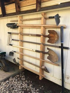 This is a guide to making a cheap and simple garden tool rack. This one is for m. This is a guide to making a cheap and simple garden tool rack. This one is for my dad's shed and keeps all the tools safely of the floor. Garage Tool Storage, Garage Tools, Shed Storage, Storage Design, Garage Organization, Craft Storage, Organization Ideas, Storage Hooks, Garden Tool Organization