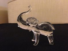 Handmade glass elephant figurine set of 7. $39.99