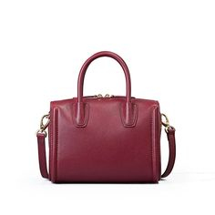 Handmade Genuine Leather Women Boston bag •Adjustable shoulder strap. •Brass hardware •Signature metal feet adorn bottom. •Length: 23cm; Height: 17cm; Width: 16cm; •Color:Grey/ Red / Black