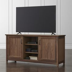 """Shop Ainsworth Walnut 64"""" Media Console with Glass/Wood Doors.   With your choice of glass or wood doors to flank the center open storage space, this versatile media console easily transitions to a sideboard or credenza."""