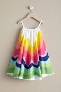 Cute & darling, this girls rainbow dress is perfect for twirls & whirls!