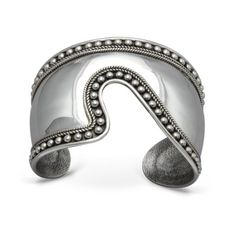 """""""Balinesia Artisan Crafted Sterling Silver Granulated Cuff Bracelet""""Bali is renowned for beautiful, highly original artisan silver jewelry - especially for the distinctive decorative technique known as granulation. This sterling silver cuff bracelet from Balinesia Design is a striking example. The cuff's graceful, asymmetrical wave shape is outlined with granulated beads and rope motif, giving rich contrast to the smooth silver surface. Featured dramatically on its own or combined…"""