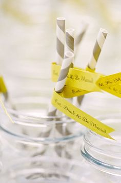 """Patterned straws are decorated with a bight yellow flag that reads, """"Eat, Drink & Be Married""""."""