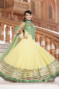 Glamorize your looks with this stylish Zoya Yellow, Green Georgette Pakistani Style Suit