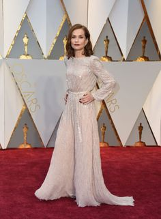 Maybe it's the innate French fashion sense, but Isabelle Huppert knows how to make a simple white Armani Privédress look asstunning as her bolder-hued peers.