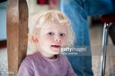 Stock Photo : Young girl sitting under the table