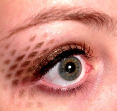 You can use old fishnet, stencils, or any other texture to create awesome makeup effects