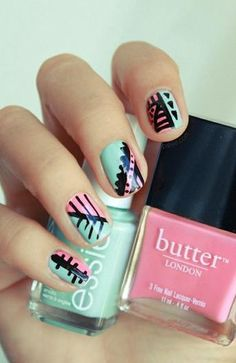 We love the bright mixture of colors underneath the graphic art on these gorgeous nails!