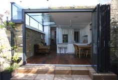 Sliding Folding Doors to rear extension - open    www.iqglassuk.com