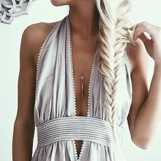 Love the braid, but that dress is WAY too low cut!