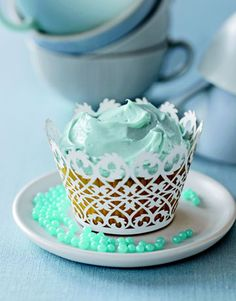 Make Ornate Cupcakes...Forgo a traditional cake for cupcakes embellished with intricate paper cuffs and colored frosting. This treat will be especially popular with any young children attending the shower with their moms.    Read more: Baby Shower Ideas - Baby Shower Food - Country Living