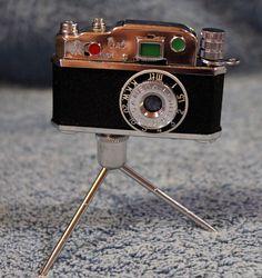 Camera on Tripod Cigarette Lighter