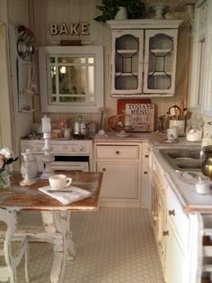 I love this shabby chic kitchen. I may need to repaint my cupboards.