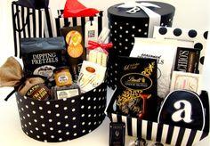 Elizabeth W. Gift Baskets featuring Nashville Wraps gift basket containers.  http://www.nashvillewraps.com/showpage.ww?page=giftbasket