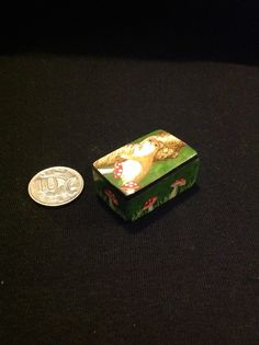 A tiny polymer clay box I made and painted for my dad with his favourite English animal, the stoat on it