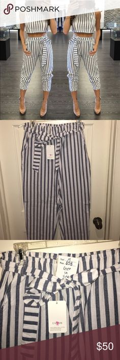Two piece High waisted set This 2 piece blue and white stripped set is amazing!!! The pants are high waisted with side pockets and the top ties in the back for an open back look! Don't miss out on this set!! Pants Ankle & Cropped