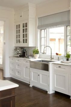 Love this kitchen with white shaker style cabinets, Carrera marble, and a STAINLESS STEEL farm sink! by Maria E Gallitelli