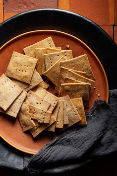 Making crackers at home is much easier than you might think! These flavorful little crisps are the healthy vegan alternative to Cheez-It crackers, perfect for dipping in hummus or enjoying on their own as a midday snack. The flavorful combination of spices, miso paste, tahini, and lemon juice adds a subtle cheesy flavor that grows more addicting with each bite. Make them gluten-free by using certified gluten-free oat flour.