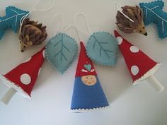 Gnomes, mushrooms, hedge hogs, and blue leaves garland.  Love.