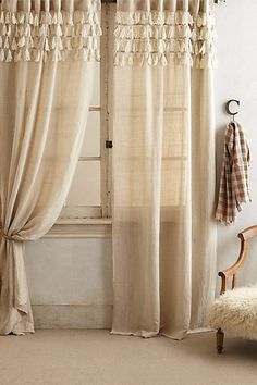 DIY - Make your own with any diy tassels or store bought tassels! Mine will be a different fabric and color! Tasseled Linen Curtain #anthropologie