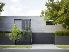 12 Minimalist Modern House Exteriors // Dark materials on the exterior of the house give it a minimalist look and contrast the greenery surrounding it. Residential Architecture, Architecture Design, Gate Design, House Design, Design Exterior, Facade House, House Exteriors, Exterior Cladding, H & M Home