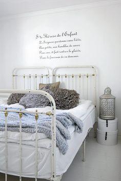A serene, white bedroom.
