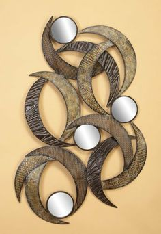 "Wrought Iron Metal Sculpture Wall Decor Art 40x24 (663)"" [Kitchen] by OctoRose. $90.00. Hand-painted handcraft various colors in shapes, aged bronze finish. Overlaying moon hug Levitating sun made this * Contemporary and abstract 3D looks. High quality Modern Art. 40x24"" in size. Illusion of textures,stunning, modern, abstract designs. Item 663 This unique handcraft, mysterious, aging look metal wall sculpture also good as table decoration. The various levitating half m..."